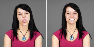 Young woman pulling tongue and smiling Stock Photo