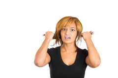 Young woman pulls out her hair in anger and frustration Stock Photos