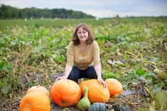 Young woman on the pumpkin patch Royalty Free Stock Photo