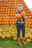 Young woman with pumpkins Royalty Free Stock Photo