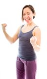 Young woman punching the air and laughing. Young adult caucasian woman isolated on a white background Stock Photography