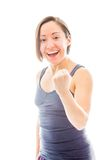 Young woman punching the air and laughing Royalty Free Stock Photo