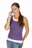 Young Woman in Puple Tank Top on Cell Phone Stock Photo