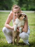 Young woman and puppy collie Royalty Free Stock Photos