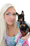 Young woman with puppy in her hands over white Royalty Free Stock Image