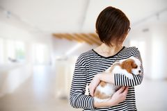 Young woman with puppy Stock Photo