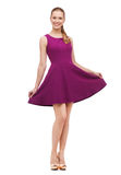 Young woman in purple dress and high heels Stock Photography
