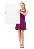 Young woman in purple dress and high heels Royalty Free Stock Photography