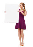 Young woman in purple dress and high heels Royalty Free Stock Photo