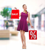 Young woman in purple dress and high heels Stock Image