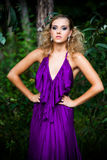 Young Woman in a Purple Dress Outdoors Royalty Free Stock Photo