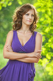 Young woman in purple dress thought Stock Photo