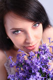 Young woman with a purple hyacinth bouquet Stock Photo