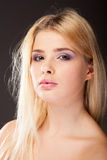 Young woman with purple makeup in studio photo royalty free stock photography