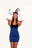 Young woman in purple mysterious venetian mask throw money Royalty Free Stock Image