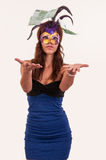 Young woman in purple mysterious venetian mask throw money Royalty Free Stock Photos