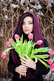 Young woman with purple scarf and tulips Royalty Free Stock Image