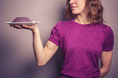 Young woman in purple serving jelly Stock Photo