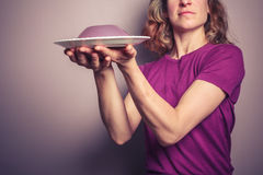 Young woman in purple serving jelly Royalty Free Stock Photos