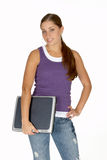 Young Woman in Purple Tank Top with Laptop Under Arm Stock Photo