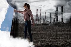 Young woman pushes the curtain looking at clouds royalty free stock photography