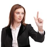 Young woman pushes on glass with finger. Young woman in business suit pushes on glass with finger. Isolated on a white background stock images