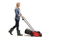 Young woman pushing a lawn mower Royalty Free Stock Images