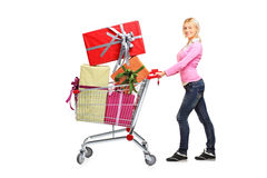 Young woman pushing a shopping cart Stock Photography