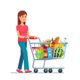 Young woman pushing supermarket shopping cart. Full of groceries. Flat style vector illustration  on white background Stock Photos