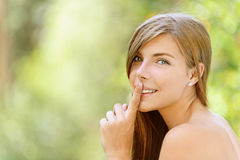 Young woman put finger on her lips Royalty Free Stock Photos