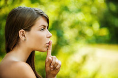 Young woman put finger on her lips Royalty Free Stock Image