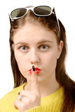 Young woman put her finger to her lips Stock Photography