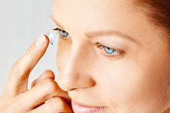 Free Young Woman Puts Contact Lens In Her Eye. Eyewear, Eyesight And Vision, Eye Care And Health, Ophthalmology And Optometry Concept, Stock Photos - 147595673