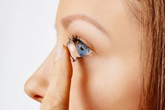 Free Young Woman Puts Contact Lens In Her Eye. Eyewear, Eyesight And Vision, Eye Care And Health, Ophthalmology And Optometry Concept Royalty Free Stock Photo - 165854265