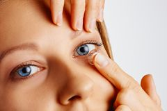 Free Young Woman Puts Contact Lens In Her Eye. Eyewear, Eyesight And Vision, Eye Care And Health, Ophthalmology And Optometry Concept Royalty Free Stock Image - 165854456