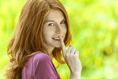Young woman puts finger to his lips Royalty Free Stock Photography