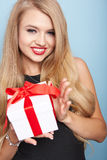 Young woman puts her ear to the present wrapped. Stock Photography