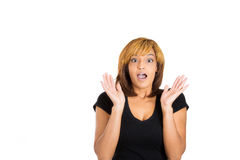 Young woman puts her hands in the air in disbelief and shock Royalty Free Stock Photography