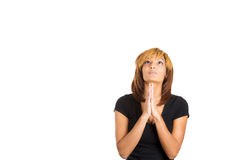 Young woman puts her hands together to pray or ask forgiveness Stock Images