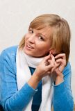 Young Woman Puts On Ear-rings Stock Photography