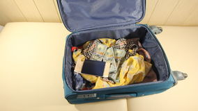 Young Woman Puts Tickets In The Suitcase And Closes The Zipper. 2 Shots. stock video footage