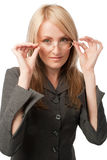 Young woman putting on glasses Stock Photos