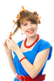 Young woman putting on hair curlers Royalty Free Stock Photo