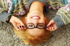 Young woman putting her glasses on Stock Photo