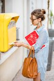 Woman using old mailbox outdoors Royalty Free Stock Photos
