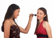 Young woman putting make up Stock Image
