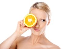 Young Woman Putting Slice of Lemon Over the Eye Royalty Free Stock Photos