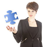 Young woman with puzzle piece Royalty Free Stock Image