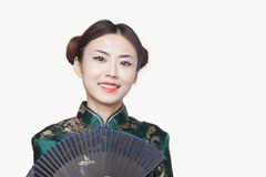 Young Woman in Qipao with Fan Royalty Free Stock Photos