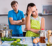Young woman quarrelling with  spouse. Offended  young women quarrelling with  spouse in domestic kitchen Stock Photo